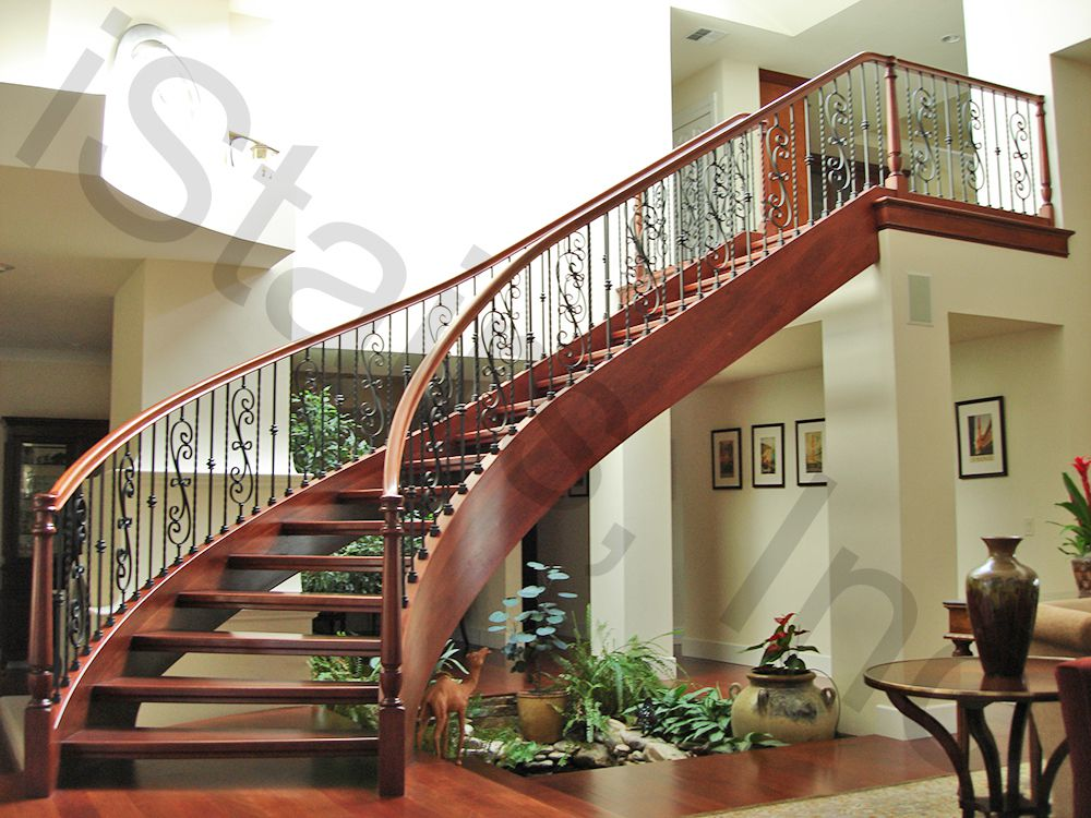 Cherry riser-less free-standing staircase w/black wrought iron balusters & turned posts