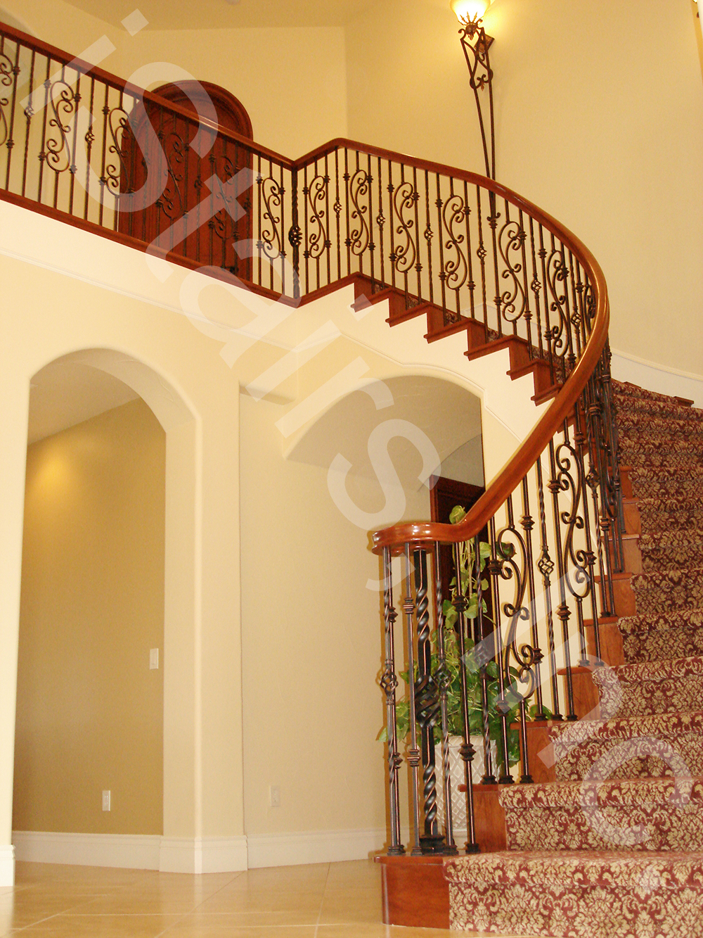 Cherry with paint grade skirt board & oil rubbed copper wrought iron balusters