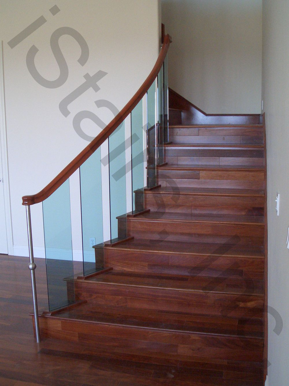 Cherry w/stainless steel newels & glass balusters over the post